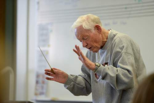 Francisco Kjolseth | The Salt Lake Tribune Jack Ashton, former longtime Utah Symphony violinist, for more than 30 years, works with the Young Artist Chamber Players at Highland High recently. The youth orchestra is getting ready for a concert tour to Europe.