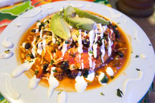 Steve Griffin  |  The Salt Lake Tribune  Mi Ranchito Grill's vegan version of pastel azteca, a casserole-styled stacked dish made with corn tortillas, enchilada sauce, soy rizo (think vegan chorizo sausage) and black beans. It costs $14.99 and is large enough to feed a family of four.