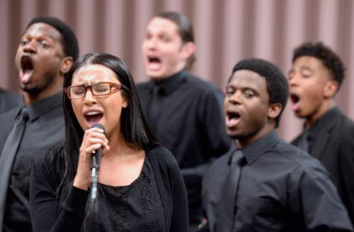 Al Hartmann  |  The Salt Lake Tribune  Raven Flowers, front, and fellow LDS Genesis Group Choir members, from left, Yahosh Bonner, David Jarvis, Oba Bonner, and Spencer Myers rehearse for an upcoming Las Vegas performance Sunday Feb. 7.  The choir is different from most LDS choirs.  They sing gospel and soul music.