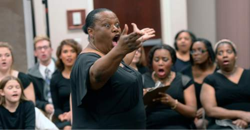 Al Hartmann  |  The Salt Lake Tribune Director Debra Bonner leads the LDS Genesis Group Choir in a rehearsal for an upcoming Las Vegas performance Sunday Feb. 7.  The choir is different from most LDS choirs.  They sing gospel and soul music.