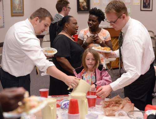 Al Hartmann     The Salt Lake Tribune Members of the LDS Genesis Group Choir take in potluck dinner before start of rehearsal for an upcoming Las Vegas performance Sunday Feb. 7.  The choir is different from most LDS choirs.  They sing gospel and soul music.