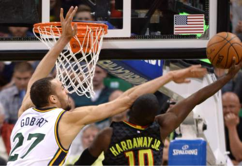 Steve Griffin  |  The Salt Lake Tribune   Utah Jazz center Rudy Gobert (27) fouls Atlanta Hawks guard Tim Hardaway Jr. (10) during the Jazz Hawks NBA game at Vivint Smart Home Arena in Salt Lake City, Tuesday, March 8, 2016.