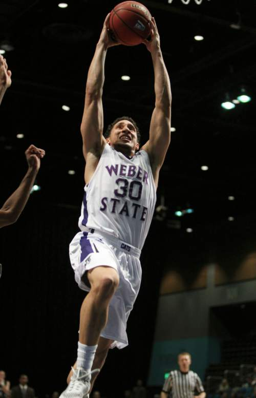 Weber State guard Jeremy Senglin scores against Montana during the second half of an NCAA college basketball game for the championship of the Big Sky men's conference tournament in Reno, Nev., Saturday, March 12, 2016. (AP Photo/Lance Iversen)