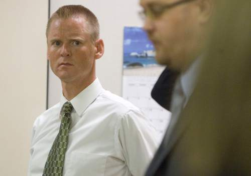 "Jim Urquhart  |  Tribune file photo  ""Super"" Dell Buck Schanze, left, listens to his attorney Harold Stone at the beginning of his criminal case Monday, June 7, 2010, at 4th District Court in Orem on a reckless driving charge."