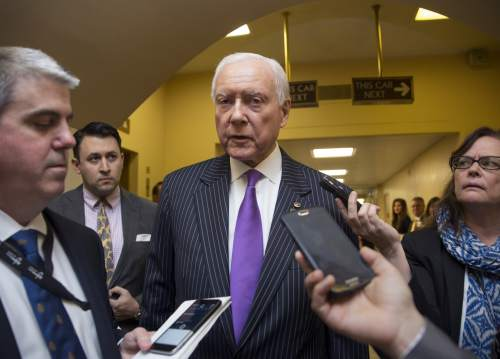 Sen. Orrin Hatch, R-Utah, a senior member of the Senate Judiciary Committee, speaks with reporters in a basement corridor at the Capitol just after President Barack Obama urged Senate Republicans to grant hearings and a confirmation vote to Merrick Garland, his nominee to replace the late Justice Antonin Scalia on the Supreme Court, in Washington, Wednesday, March 16, 2016.  (AP Photo/J. Scott Applewhite)