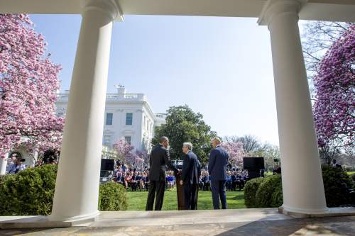 Federal appeals court judge Merrick Garland, center, accompanied by Vice President Joe Biden, right, shakes hands with President Barack Obama as he is introduced as Obama's nominee for the Supreme Court during an announcement in the Rose Garden of the White House, in Washington, Wednesday, March 16, 2016. Garland, 63, is the chief judge for the United States Court of Appeals for the District of Columbia Circuit, a court whose influence over federal policy and national security matters has made it a proving ground for potential Supreme Court justices. (AP Photo/Andrew Harnik)