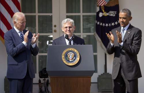 Federal appeals court judge Merrick Garland, receives applauds from President Barack Obama and Vice President Joe Biden as he is introduced as Obama's nominee for the Supreme Court during an announcement in the Rose Garden of the White House, in Washington, Wednesday, March 16, 2016. Garland, 63, is the chief judge for the United States Court of Appeals for the District of Columbia Circuit, a court whose influence over federal policy and national security matters has made it a proving ground for potential Supreme Court justices. (AP Photo/Pablo Martinez Monsivais)