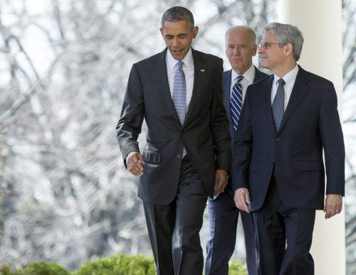 Federal appeals court judge Merrick Garland walks with President Barack Obama and Vice President Joe Biden from the Oval Office to the Rose Garden to be introduced as Obama's nominee for the Supreme Court at the White House, in Washington, Wednesday, March 16, 2016. (AP Photo/Andrew Harnik)