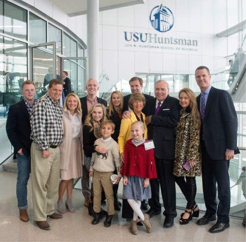 Rick Egan  |  The Salt Lake Tribune  John M. Huntsman gathers together with some of his family members as they celebrate the new $50 Million building in the Jon M. Huntsman School of Business, Wednesday, March 16, 2016.