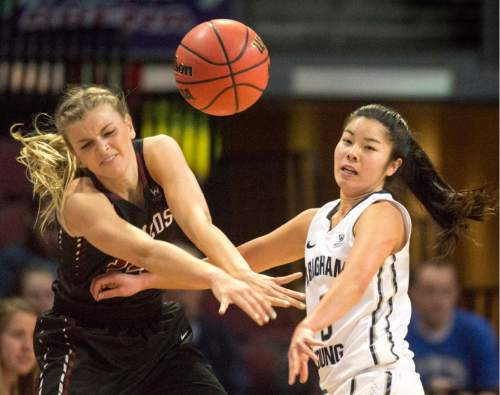 Rick Egan  |  The Salt Lake Tribune  Santa Clara Broncos forward Marie Bertholdt (15) and Brigham Young Cougars guard Kylie Maeda (3) for for a the ball, in basketball action in the West Coast Conference Semifinals, at the Orleans Arena in Las Vegas, Saturday, March 7, 2016.