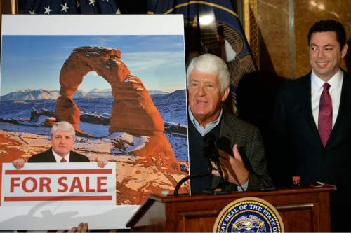 "Al Hartmann  |  The Salt Lake Tribune Utah Congressman Rob Bishop shows a poster criticising his views of federal land use as Congressman Jason Chaffetz chuckles.  Bishop said that it was an old photo of him 60 lbs. heavier and that a new photo should be used. The three then unveield a ""discussion draft"" of their Public Lands Initiative bill affecting 18 million acres in seven eastern Utah counties at the  Capitol Tuesday Jan 20.  Bishop intends on introducing the bill in congress in the next few weeks."