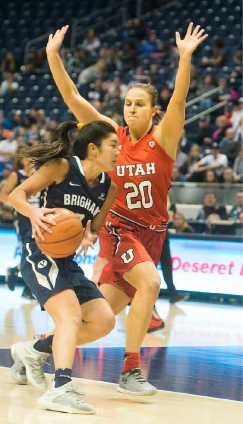 Rick Egan     The Salt Lake Tribune  Brigham Young Cougars guard Kylie Maeda (3) brings the ball down as  Utah Utes guard Katie Kuklok (20) defends  in basketball action, BYU vs. The Univeristy of Utah,  in the Marriott Center, Saturday, December 12, 2015.