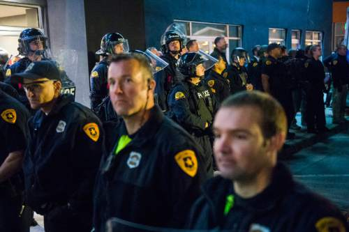 Chris Detrick     The Salt Lake Tribune Members of the Salt Lake City Police Department and Utah Highway Patrol watch as people protest Republican presidential candidate Donald Trump outside of the Infinity Event Center Friday March 18, 2016.