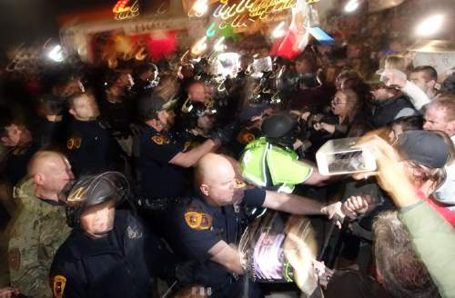 Lennie Mahler  |  The Salt Lake Tribune  Police push back after protesters tore down a tent at the door of Infinity Events Center in Salt Lake City, as presidential candidate Donald Trump spoke inside Friday, March 18, 2016.