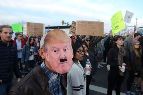 Lennie Mahler     The Salt Lake Tribune  Protesters gather around Infinity Events Center as Republican presidential candidate Donald Trump was scheduled to speak Friday, March 18, 2016.