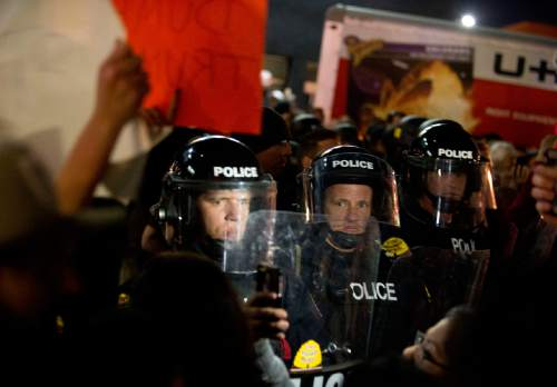 Lennie Mahler  |  The Salt Lake Tribune  Police form a line in riot gear after protesters tore down a tent at the door of Infinity Events Center in Salt Lake City, as presidential candidate Donald Trump spoke inside Friday, March 18, 2016.