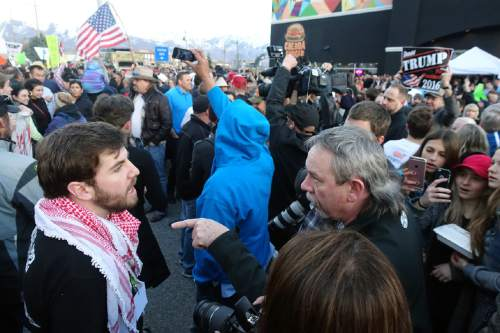 Lennie Mahler     The Salt Lake Tribune  Protesters and Trump supporters argue around Infinity Events Center as Republican presidential candidate Donald Trump was scheduled to speak Friday, March 18, 2016.