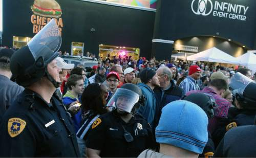 Lennie Mahler  |  The Salt Lake Tribune  Police and protesters gather around Infinity Events Center in Salt Lake City, as presidential candidate Donald Trump spoke inside Friday, March 18, 2016.