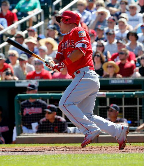 Los Angeles Angels' Mike Trout follows through on a base hit during the first inning of a spring training baseball game against the Cleveland Indians, Wednesday, March 16, 2016, in Goodyear, Ariz. (AP Photo/Matt York)