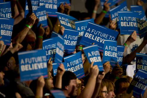 Jeremy Harmon  |  The Salt Lake Tribune  Supporters hold up signs during a Bernie Sanders rally at West High in Salt Lake City on Monday, March 21, 2016. The Democratic presidential candidate spoke in Utah on the eve of the 2016 caucus.