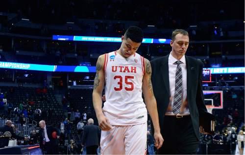 Scott Sommerdorf      The Salt Lake Tribune   Utah F Kyle Kuzma (35) walks off the court with Utah's Director of Basketball Operations, Phil Cullen after Gonzaga beat Utah 82-59 in Denver, Saturday, March 19, 2016.
