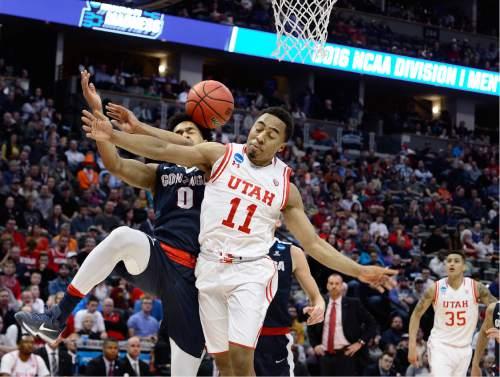 Scott Sommerdorf      The Salt Lake Tribune   Utah G Brandon Taylor's drive to the hoop is broken up by Gonzaga G Silas Melson (0) during second half play. Gonzaga beat Utah 82-59 in Denver, Saturday, March 19, 2016.