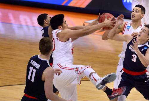 Scott Sommerdorf      The Salt Lake Tribune   Utah F Chris Reyes (20) battles under the hoop during first half play. Gonzaga beat Utah 82-59 in Denver, Saturday, March 19, 2016.