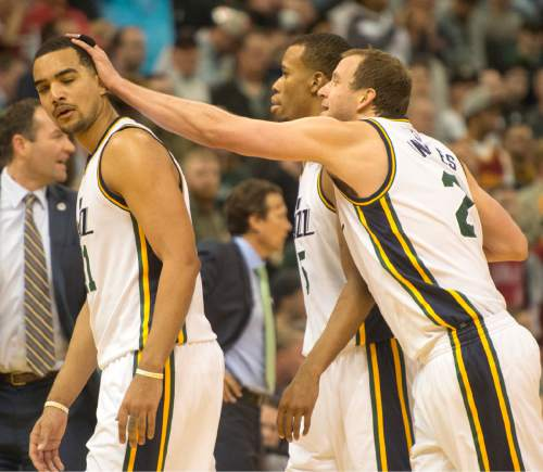Rick Egan  |  The Salt Lake Tribune  Utah Jazz forward Joe Ingles (2) pats Utah Jazz forward Trey Lyles (41) on the head, after he got mixed up with Cleveland Cavaliers forward Channing Frye (9), both Lyles and Frye were ejected from the game, in NBA action, in Salt Lake City, Monday March 14, 2016.