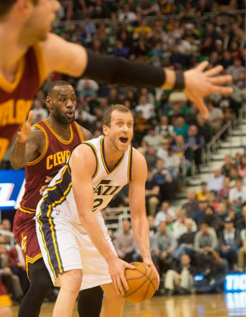 Rick Egan  |  The Salt Lake Tribune  Utah Jazz forward Joe Ingles (2) looks for an open man ,as he us guarded by Cleveland Cavaliers forward LeBron James (23), in NBA action, in Salt Lake City, Monday March 14, 2016.