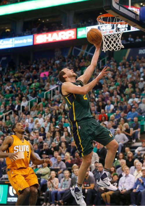 Utah Jazz's Joe Ingles, right, shoots a layup as Phoenix Suns' Brandon Knight (3) watches during the second half of an NBA basketball game Thursday, March 17, 2016, in Salt Lake City. The Jazz won 103-69. (AP Photo/Kim Raff)