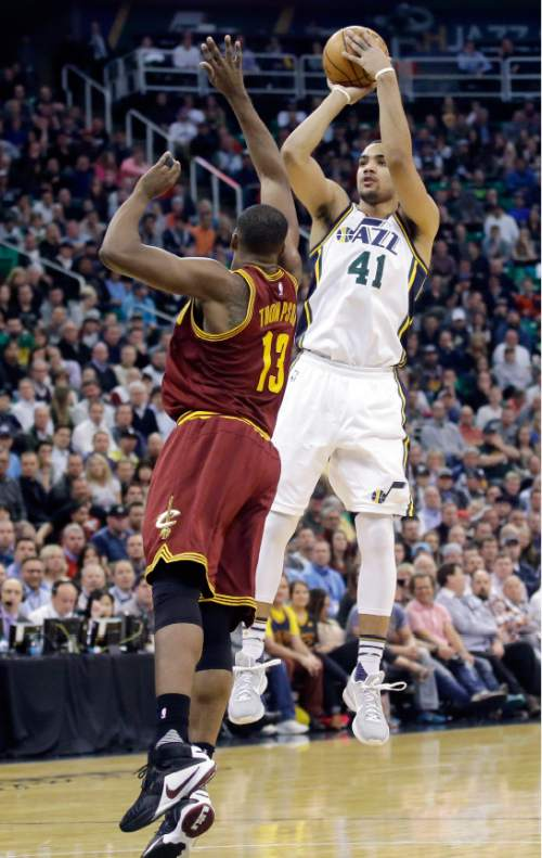 Utah Jazz forward Trey Lyles (41) shoots as Cleveland Cavaliers center Tristan Thompson (13) defends during the second half of an NBA basketball game Tuesday, March 15, 2016, in Salt Lake City. The Jazz won 94-85. (AP Photo/Rick Bowmer)