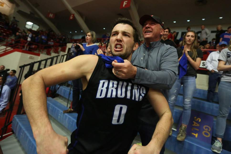Gibson Johnson celebrates with his father Matt Johnson in the stands after winning the championship game of the NJCAA tournament 74-63 over Hutchinson Saturday, March 19, 2016, at the Sports Arena in Hutchinson, Kan. (Travis Morisse/The Hutchinson News via AP ) MANDATORY CREDIT
