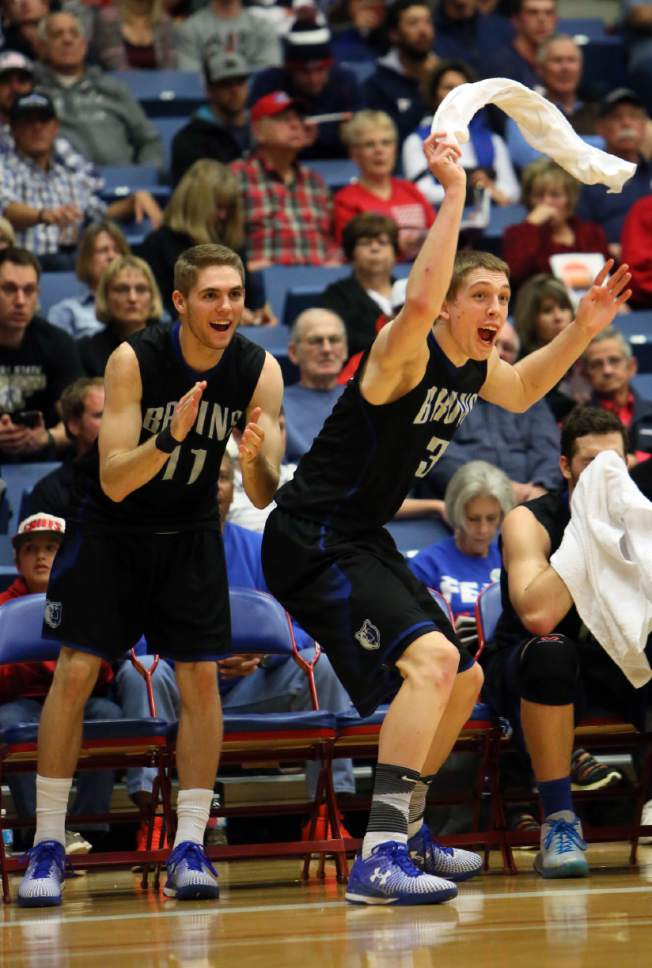 Salt Lake's Conner Toolson (11) and Tyler Rawson (3) celebrate during the second half against Gillette College in a semifinal at the NJCAA basketball tournament Friday, March 18, 2016, in Hutchinson, Kan. (Lindsey Bauman/The Hutchinson News via AP)