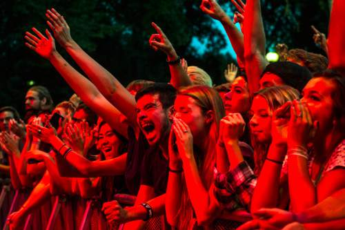 Chris Detrick  |  The Salt Lake Tribune Fans cheer as Local Natives perform during the Twilight Concert Series at Pioneer Park Thursday August 7, 2014.