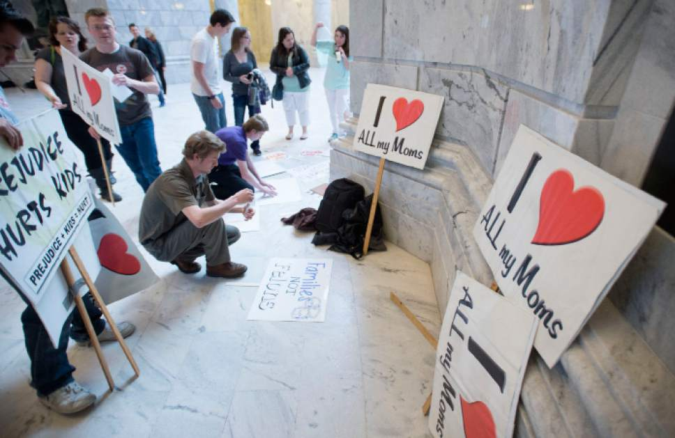 Steve Griffin  |  The Salt Lake Tribune People make signs as they attend a protest rally against H.B. 281 that if passed make polygamy a felony in Utah again. Members of Utah's plural marriage community are not happy and rallied against the bill in the Capitol Rotunda during the 2016 legislative session in Salt Lake City on Monday.