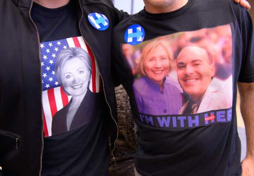 Leah Hogsten  |  The Salt Lake Tribune Sebastian De-Freitas (right) wore a shirt with a photo of he and Hillary Clinton to the caucus with his friend Mauro Gusman, who sported a Hillary shirt as well. Lines and wait times were long at the Democratic caucus at Clayton Middle School as both registered party members and unaffiliated voters cast their ballots, Tuesday, March 22, 2016.
