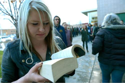 Leah Hogsten  |  The Salt Lake Tribune Kristin Maloney read another 100 pages of her book in the 1.5 hours it took her to reach the front door of the school. Lines and wait times were long at the Democratic caucus at Mountain View Elementary School as both registered party members and unaffiliated voters cast their ballots, Tuesday, March 22, 2016.