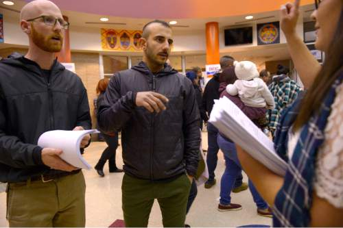 Leah Hogsten  |  The Salt Lake Tribune Salt Lake County councilman Derek Kitchen and spouse Moudi Sbeity receive provisional ballots from Cree McNulty to hand out to voters. Lines and wait times were long at the Democratic caucus at Mountain View Elementary School as both registered party members and unaffiliated voters cast their ballots, Tuesday, March 22, 2016.