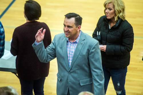 Chris Detrick  |  The Salt Lake Tribune Speaker of the House Gregory H. Hughes (R-Draper) talks to voters in precinct 13 during the Republican caucus at Corner Canyon High School Tuesday March 22, 2016.