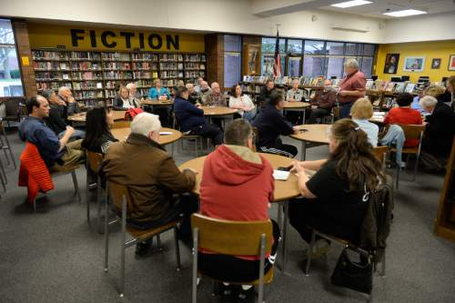 Francisco Kjolseth | The Salt Lake Tribune Republicans gather inside the Library and Media Center at at Cottonwood High School for the GOP caucus on Tuesday night, March 22, 2016.