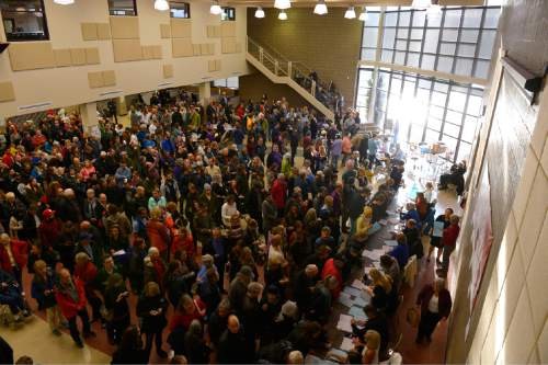 Leah Hogsten  |  The Salt Lake Tribune Lines and wait times were long at the Democratic caucus at Clayton Middle School as both registered party members and unaffiliated voters cast their ballots, Tuesday, March 22, 2016.