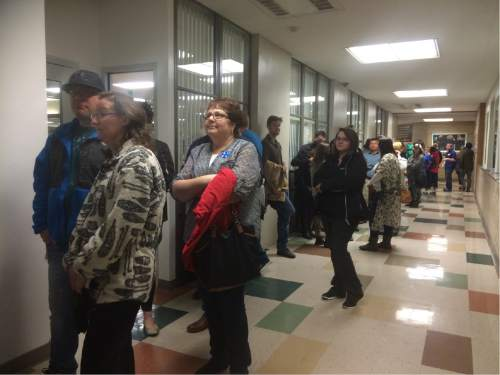 Wendy Ogata  |  Courtesy  Lines of Democratic caucus voters snake through the halls of Roy High School on Tuesday, March 22, 2016.