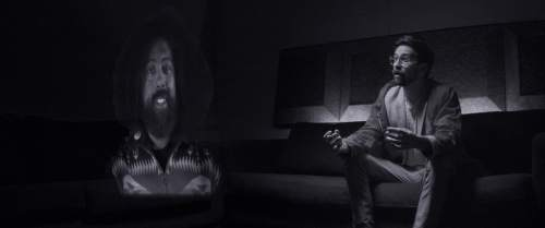 "|  Magnolia Pictures  David (Benjamin Dickinson, right) calls Reggie Watts (playing himself) over an augmented-reality link in the futuristic drama ""Creative Control."""