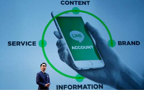 Line Corp. President & CEO Takeshi Idezawa speaks during a press conference of Line Conference Tokyo 2016 in Urayasu, near Tokyo, Thursday, March 24, 2016. Line Corp., which offers a popular mobile message and online voice-call service, is entering the mobile carrier business in Japan, promising to underprice competition, as it plans to keep growing as a platform for news, music, games, live streaming and online shopping. Tokyo-based Line, founded five years ago, already has a billion global registered users, 215 million of them active each month on average. (AP Photo/Shizuo Kambayashi)