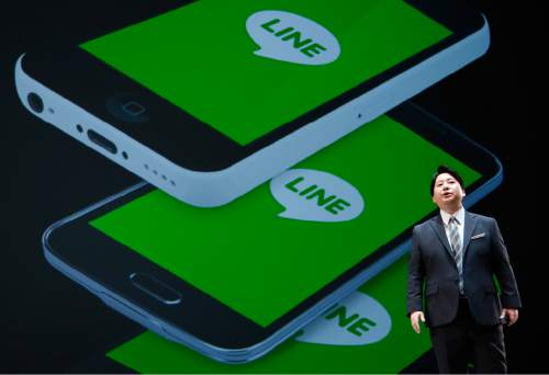 Line Corp. Chief Strategy and Marketing Officer Jun Masuda speaks during a press conference of Line Conference Tokyo 2016 in Urayasu, near Tokyo, Thursday, March 24, 2016.  Line Corp., which offers a popular mobile message and online voice-call service, is entering the mobile carrier business in Japan, promising to underprice competition, as it plans to keep growing as a platform for news, music, games, live streaming and online shopping. (AP Photo/Shizuo Kambayashi)
