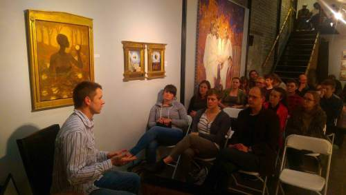 "Courtesy photo Mormon artist J. Kirk Richards discusses his painting ""Eve and the Fruit of the Tree of Knowledge"" with patrons at Provo's Writ & Vision gallery."