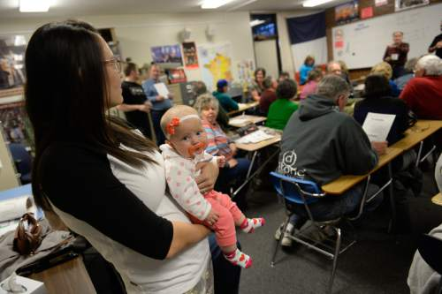 Francisco Kjolseth | The Salt Lake Tribune Lily Blauer, 4-months, keep calm with the help of a binky as her mother Marissa attends a GOP caucus meeting at Cottonwood High School on Tuesday night, March 22, 2016.