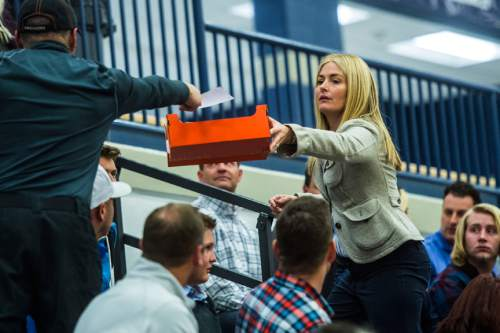 Chris Detrick  |  The Salt Lake Tribune Carolyn Phippen collects Presidential ballets from voters in precinct 13 during the Republican caucus at Corner Canyon High School Tuesday March 22, 2016.