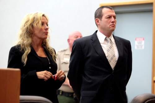 Geoff Liesik  |  Pool Photo Brian Gomez, right, stands with defense attorney Chelsea Koch in 4th District Court on  Aug. 18 2015, after Judge Roger Griffin declared a mistrial in the child sex abuse case filed against Gomez by prosecutors in Wasatch County. It was the second time a mistrial had been declared in the case due to an inability to seat an impartial jury.