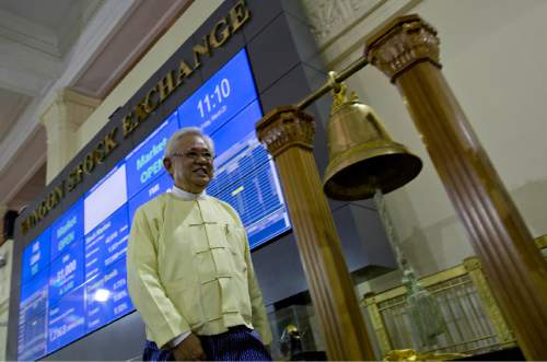 Serge Pun executive chairman of First Myanmar Investment walks as electronic trading commences during the opening day of trading at Yangon Stock Exchange in Yangon, Myanmar, Friday, March 25, 2016. Myanmar's new stock exchange, the Yangon Stock Exchange (YSX) officially opened for business on Friday more than three months after it was launched in December 2015.(AP Photo/ Gemunu Amarasinghe)